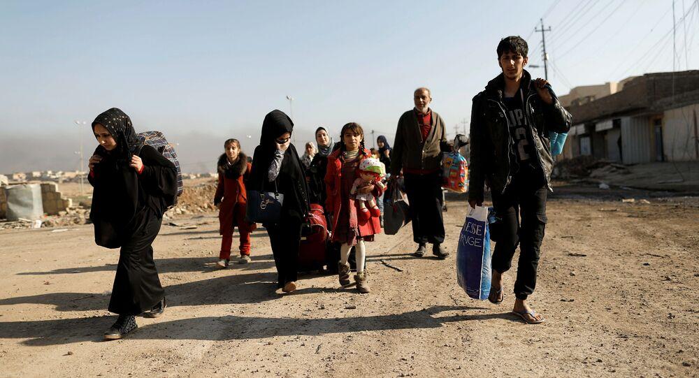 أسر كاملة نازحة من الموصل