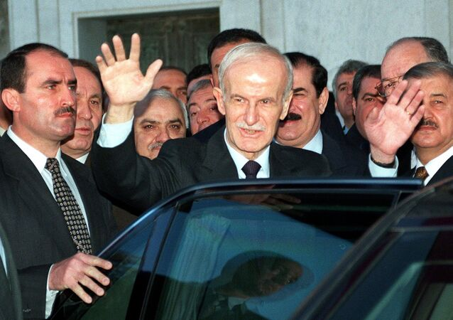 Syrian president Hafez al-Assad salutes people after attending Eid Al-Adha, or feast of sacrifice, prayers 27 March 1999 in Damascus
