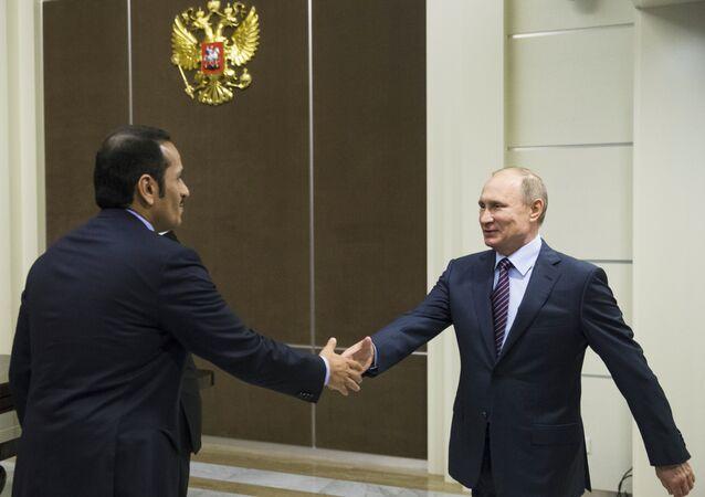 Russian President Vladimir Putin, right, shakes hands with Qatar Foreign Minister Mohammed bin Abdulrahman bin Jassim Al-Thani before their meeting in Sochi, Russia, Friday, May 6, 2016