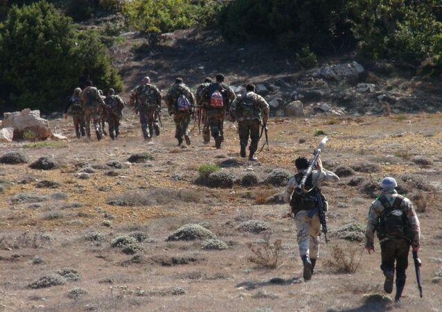 تدريبات عسكرية سورية تساوي بين المسلحين و إسرائيل