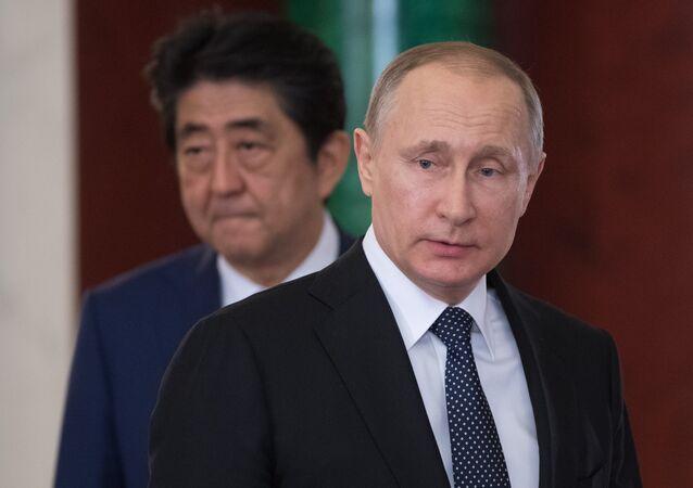 بوتين وآبي