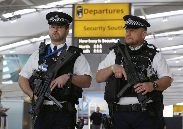 Armed police patrol at Terminal 5, Heathrow Airport in London, Britain March 22, 2016.