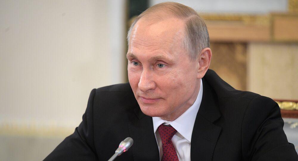Russian President Vladimir Putin speaks during a meeting with representatives of international news agencies in St. Petersburg, Russia