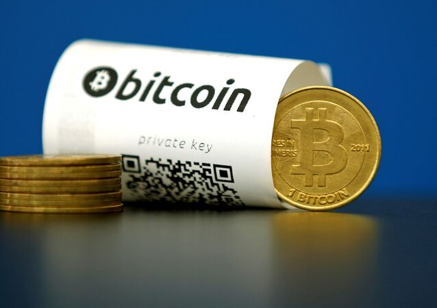 A Bitcoin (virtual currency) paper wallet with QR codes and a coin are seen in an illustration picture taken at La Maison du Bitcoin in Paris, France May 27, 2015