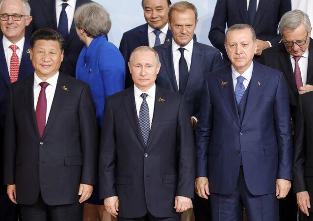قمة مجموعة العشرين في هامبورغ، ألمانيا - الرئيس الروسي فلاديمير بوتين والرئيس التركي رجب طيب أردوغان، والرئيس الصيني شي جين بينغ، 7 يوليو/ تموز 2017