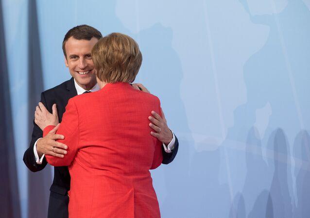 قمة مجموعة العشرين في هامبورغ، ألمانيا - المستشارة الألمانية أنجيلا ميركل تلتقي بالرئيس الفرنسي إمانويل ماكرون، 7 يوليو/ تموز 2017