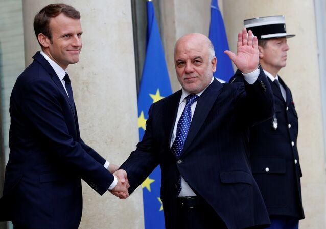 رئيس وزراء العراق حيدر العبادي مع الرئيس الفرنسي إيمانويل ماكرون