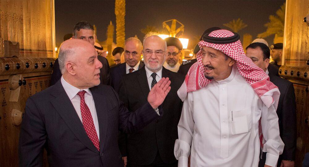 العاهل السعودي الملك سلمان ورئيس وزراء العراق حيدر العبادي