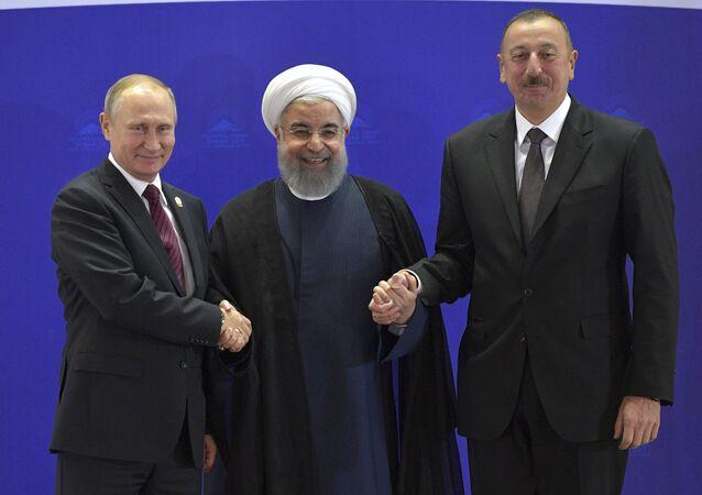 إلهام علييف وحسن روحاني وفلاديمير بوتين