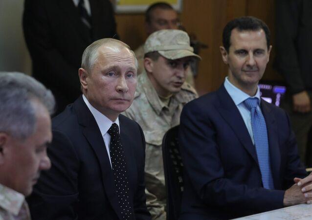 الرئيس فلاديمير بوتين والرئيس بشار الأسد في القاعدة حميميم، سوريا 11 ديسمبر/ كانون الأول 2017