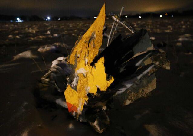 حادثة سقوط الطائرة الروسية أن-148 - أجزاء من الطائرة المنكوبة في ضواحي موسكو