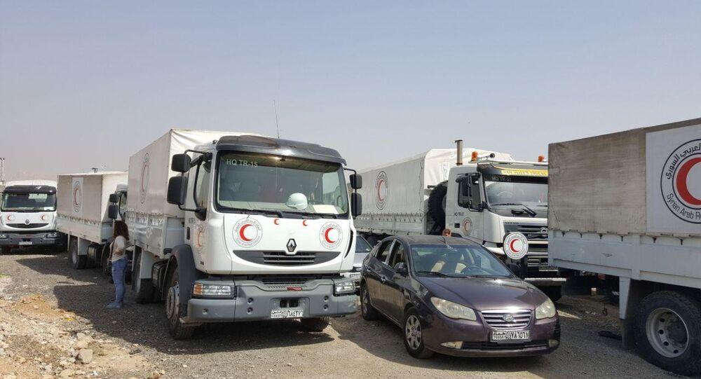 وصول قافلة المساعدات الإنسانية المتوجهة للغوطة الشرقية إلى مخيم الوافدين