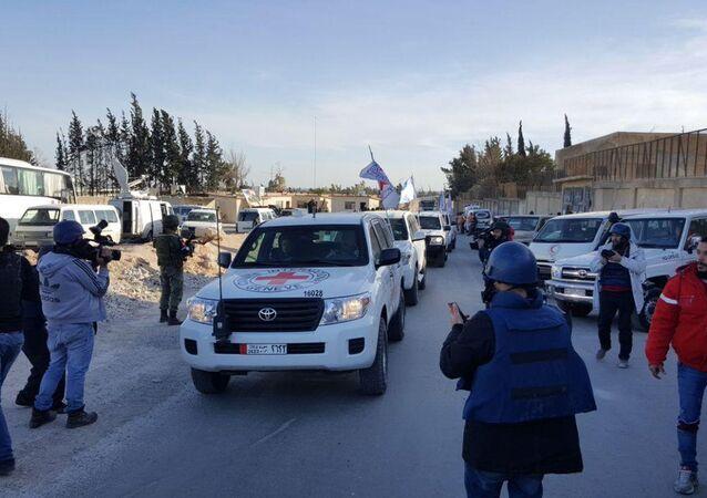 عودة قافلة المساعدات الإنسانية الدولية بنجاح من الغوطة الشرقية  إلى حاجز مخيم الوافدين