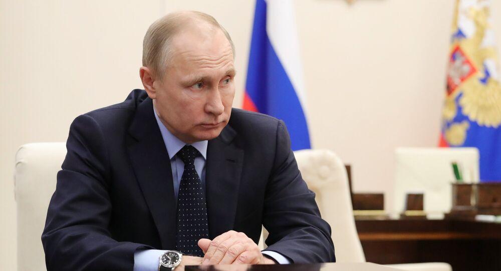 الرئيس الروسي فلاديمير بوتين خلال اجتماع حول تحقيق بحادثة كيميروفو، 28 مارس/آذار