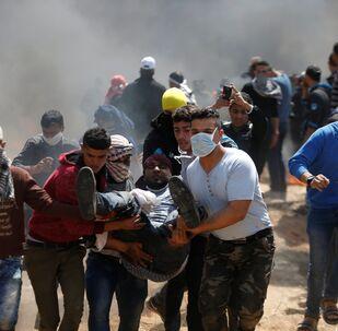 جرحى ومصابين خلال الاشتباكات بين الفلسطينيين والجنود الإسرائيليين على حدود قطاع غزةفي جمعة الكوشوك، مسيرة العودة،، فلسطين، 6 أبريل/ آذار 2018