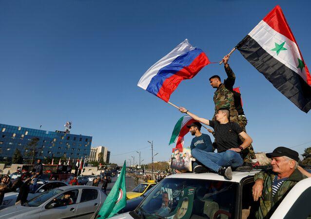 مسيرات السوريين ضد ضربة التحالف الثلاثي