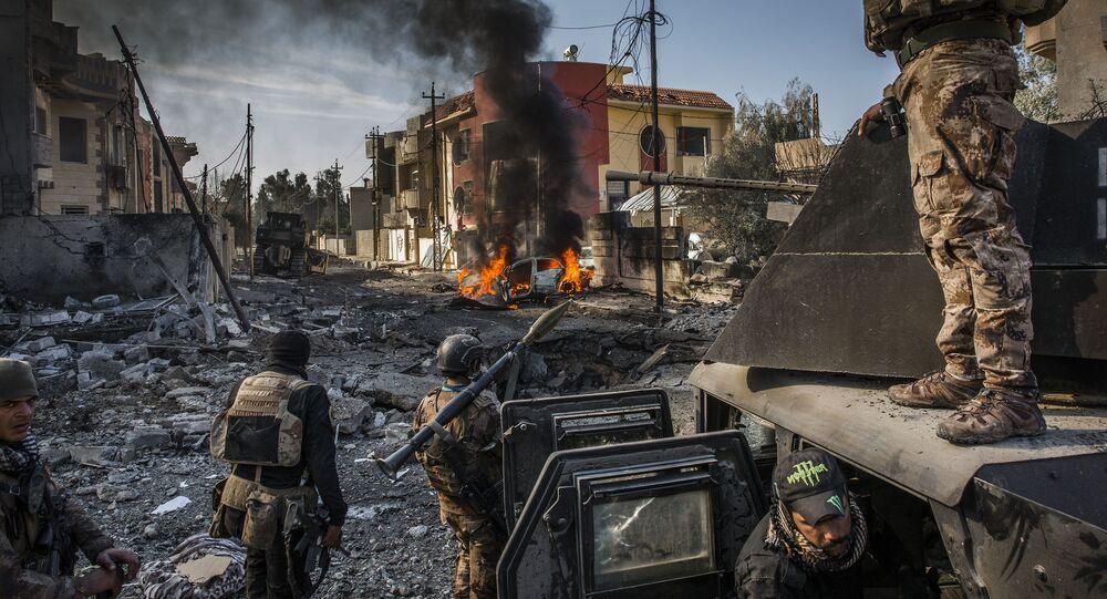 مسابقة صور الصحافة العالمية لعام 2018 - صورة بعنوان المعركة من أجل الموصل للمصور إفور بريكيت من أيرلندا، الفائزة بالمرتبة الأولىفي فئة أخبار عامة