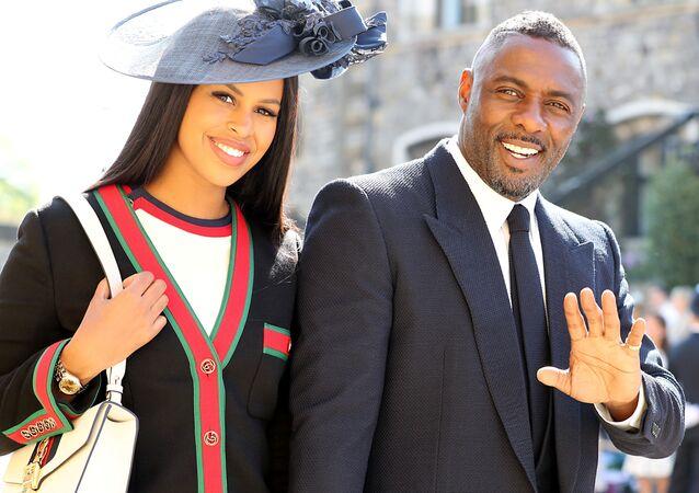 إدريس ألبا وزوجته في حفل الزفاف الملكي