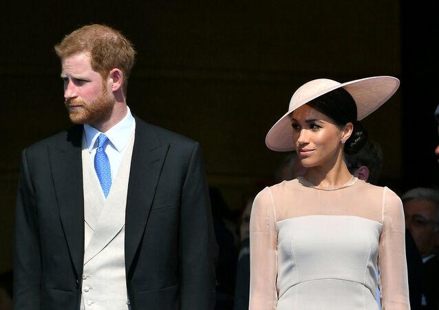 الأمير البريطاني هاري و زوجته ميغان ماركل، دوقة ساسيكس يحضران حفلة في حديقة قصر باكنغهام، أول مشاركة ملكيّة لهما كزوجين، في لندن، 22 مايو/أيار 2018