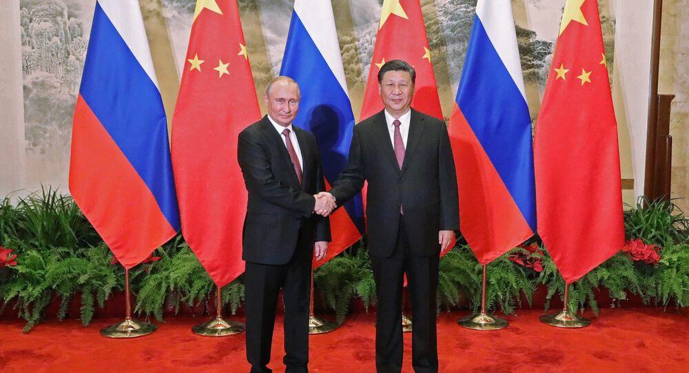 استقبال الرئيس الصيني للرئيس الروسي فلاديمير بوتين