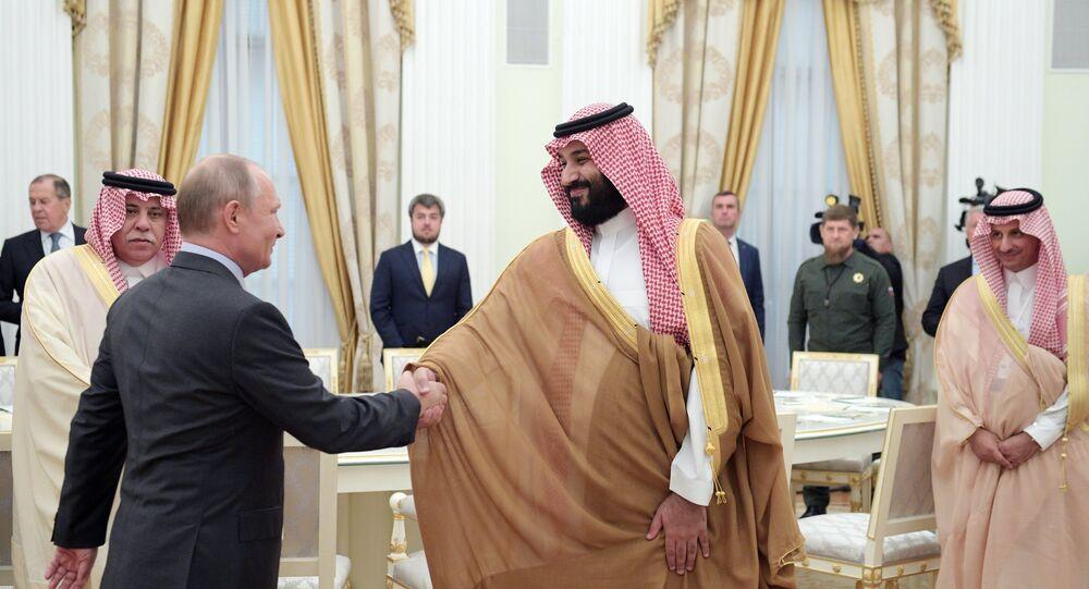 الرئيس الروسي فلاديمير بوتين يلتقي مع ولي العهد السعودي محمد بن سلمان في موسكو (14 يونيو/حزيران 2018)