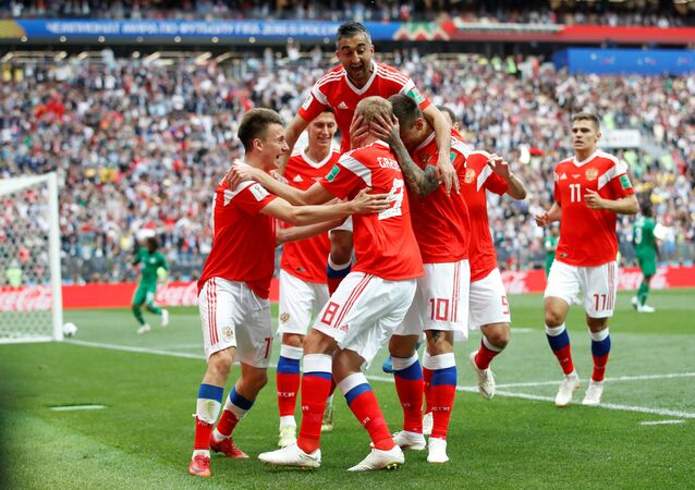 Soccer Football - World Cup - Group A - Russia vs Saudi Arabia - Luzhniki Stadium, Moscow, Russia - June 14, 2018 Russia's Yury Gazinsky celebrates scoring their first goal with team mates