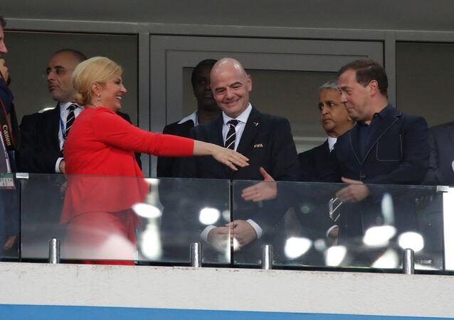 رئيسة كرواتيا ورئيس وزراء روسيا في مباراة روسيا وكرواتيا