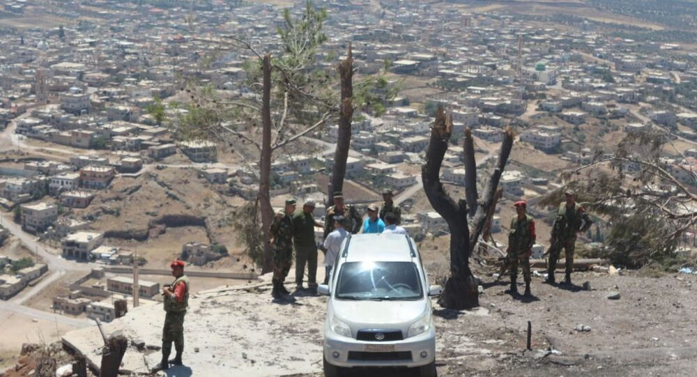 مسلحو نوى بريف درعا يسلمون أسلحتهم الثقيلة ويؤازرون الجيش السوري في مواجهة داعش
