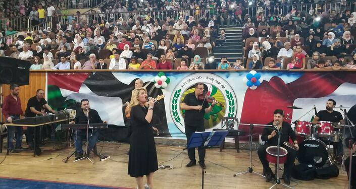 مساعدات أنغوشية لألف عائلة حلبية وغناء من الفلكلور السوري