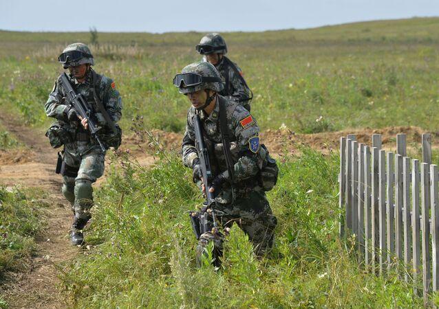 المناورات المشتركة لمنظمة شنغهاي للتعاون مهمة السلام-2018 في حقل للتدريبات في تشيباركول في روسيا