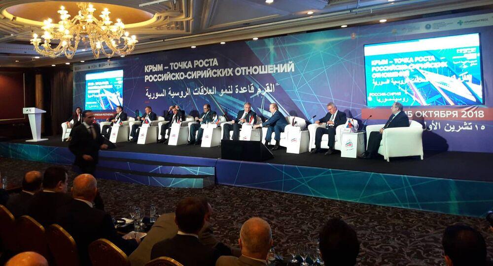 جانب من ملتقى القرم قاعدة لنمو العلاقات الروسية السورية في دمشق - رئيس جمهورية القرم سيرغي أكسيونوف