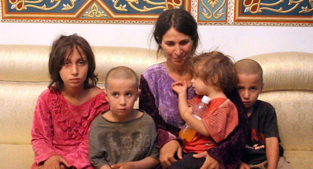 سيدة سورية من مدينة السويداء مختطفة مع أولادها عند التنظيم الإرهابي داعش