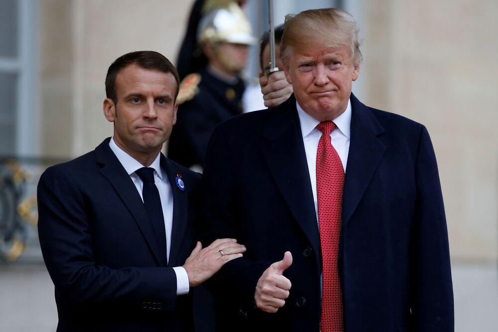 الرئيس الفرنسي إيمانويل ماكرون يرحب بالرئيس الأمريكي دونالد ترامب في باريس، فرنسا 10 نوفمبر/ تشرين الثاني 2018