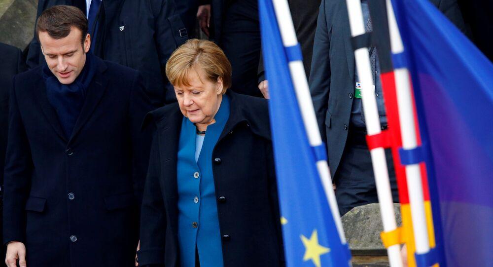 المستشارة الألمانية أنغيلا ميركل، والرئيس الفرنسي إيمانويل ماكرون