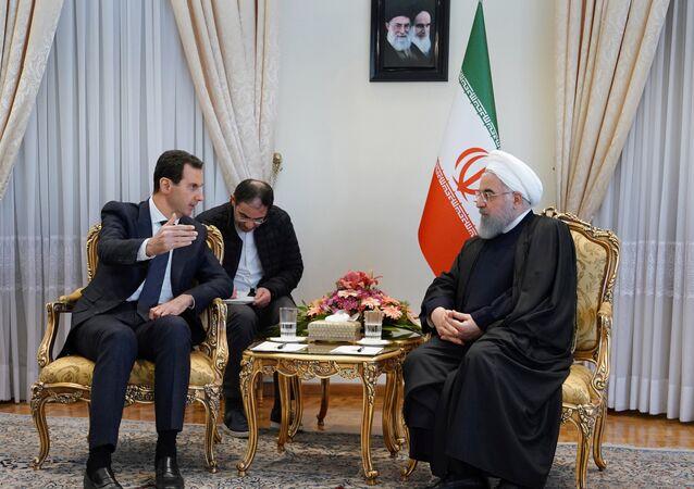 الرئيس الإيراني يستقبل الرئيس السوري بشار الأسد في طهران