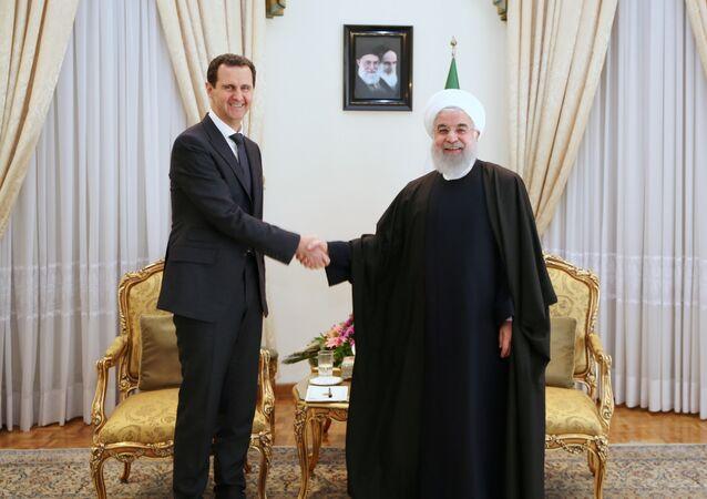 الرئيس الإيراني حسن روحاني يستقبل الرئيس السوري بشار الأسد في طهران