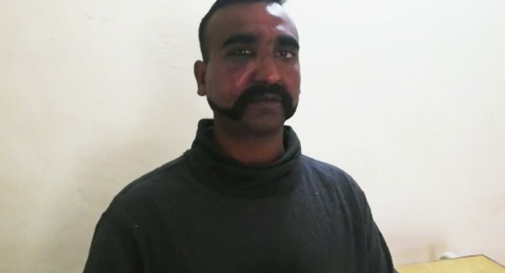 This image taken from video released by Pakistan's military, shows what they claim to be an Indian pilot who was captured after his plane was shot down by Pakistan's Air Force in the country's part of Kashmir. This week's standoff between India and Pakistan is their latest in a long dispute over the divided Himalayan region of Kashmir, dating back to their independence in 1947.