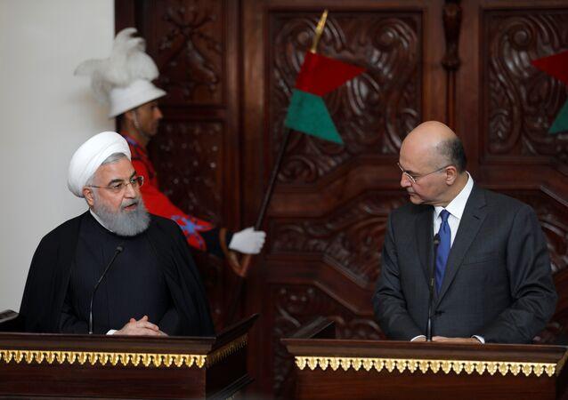 الرئيس العراقي برهم صالح في مؤتمر صحفي مع نظيره الإيراني حسن روحاني