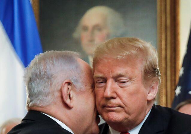 نتنياهو وترامب بعد اعتراف الرئيس الأمريكي بأن الجولان إسرائيلية