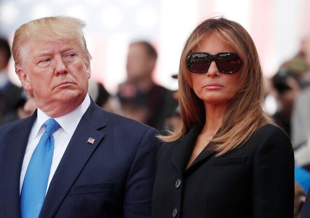 ميلانيا ترامب مع زوجها الرئيس الأمريكي دونالد ترامب في الذكرى الـ 75 لإنزال النورماندي في فرنسا، 6 يونيو/حزيران 2019