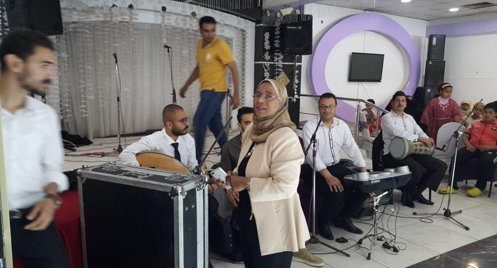 إيمان جنيدي إيمان جنيدي أول سيدة من صعيد مصر تقود فرقة موسيقية خاصة