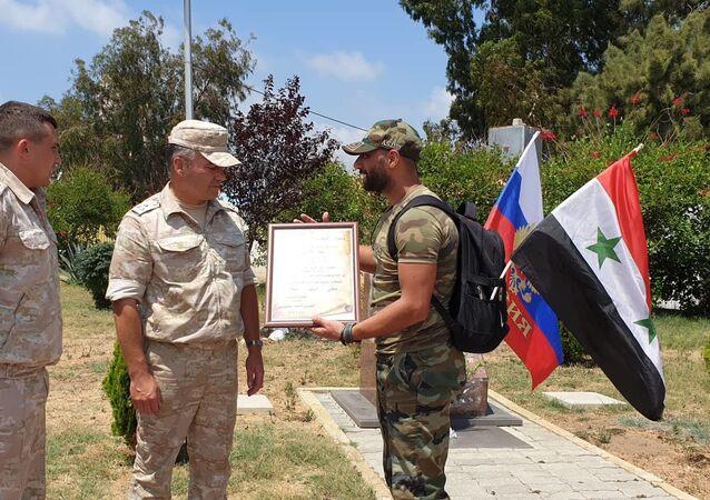 جندي سوري يوجه رسالة الوفاء 2 للأسد وروسيا