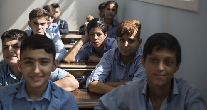 تلاميذ مدرسة الشهيد عدنان كولكي في حي برزة بدمشق، سوريا