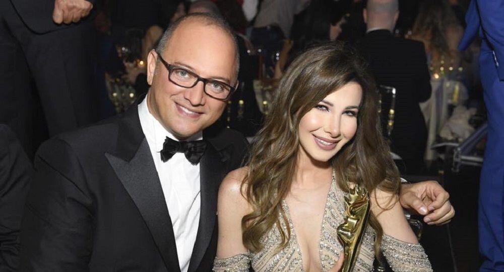 الفنانة اللبنانية نانسي عجرع مع زوجها فادي الهاشم