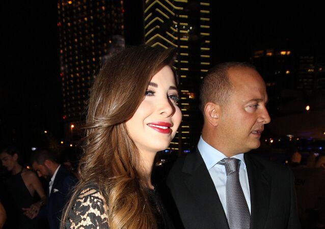 المطربة اللبنانية نانسي عجرم مع زوجها فادي الهاشم