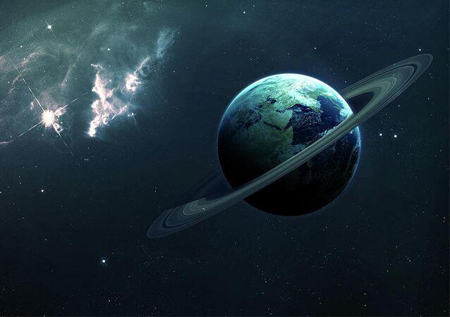 عرض كوكب الأرض محاط بحلقات مثل زحل