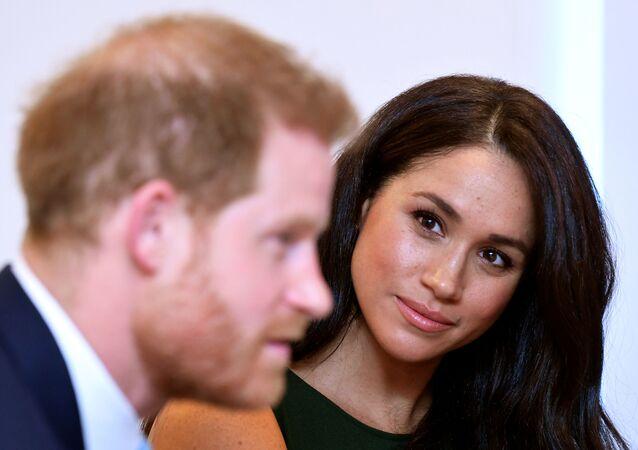 ميغان ماركل تتابع زوجها الأمير البريطاني هاري