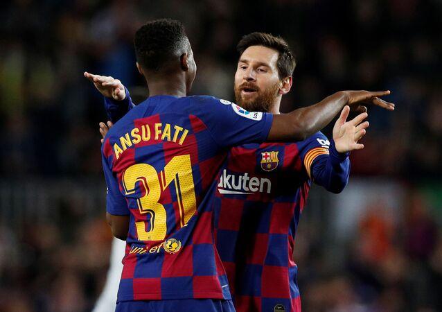ليونيل ميسي وأنسو فاتي لاعبا برشلونة