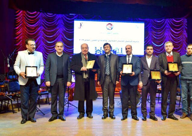 حفل تكريم للفائزين بجائزة الباسل للإنتاج الفكري والإبداع الفني في نسختها الخامسة والعشرين وذلك على مسرح نقابة الفنانين بحلب
