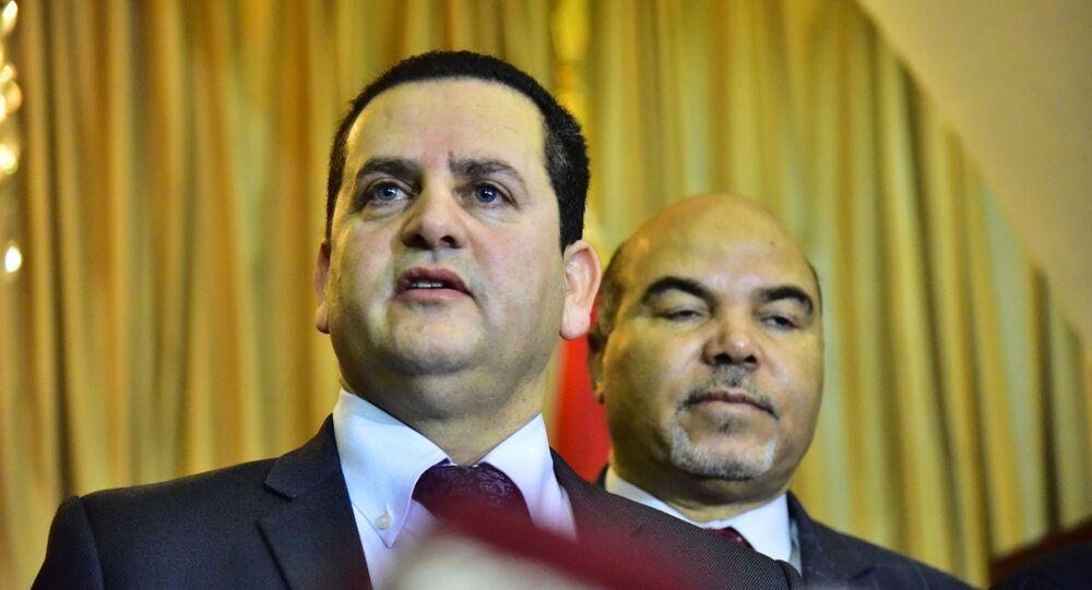وزير خارجية الحكومة الليبية المؤقتة، عبد الهادي الحويج، في افتتاح السفارة الليبية في دمشق، سوريا
